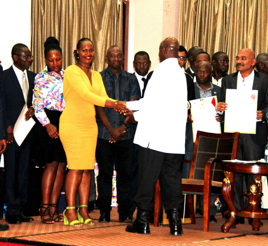 NAPE staff shaking the hand of the president after receiving the award